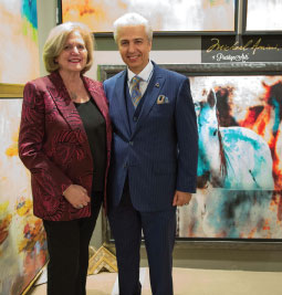 Janet Guy of Prestige Arts and Michael Amini of AICO are introducing a new wall art line, Michael Amini by Prestige Arts.