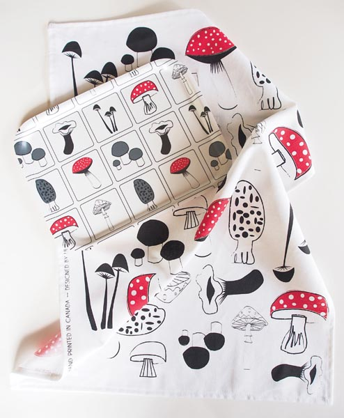 The latest line of textile and tray prints, Forest Fungi, includes a birch wood tray, tea towel, placemat, tote and ceramic canister. luprints.com