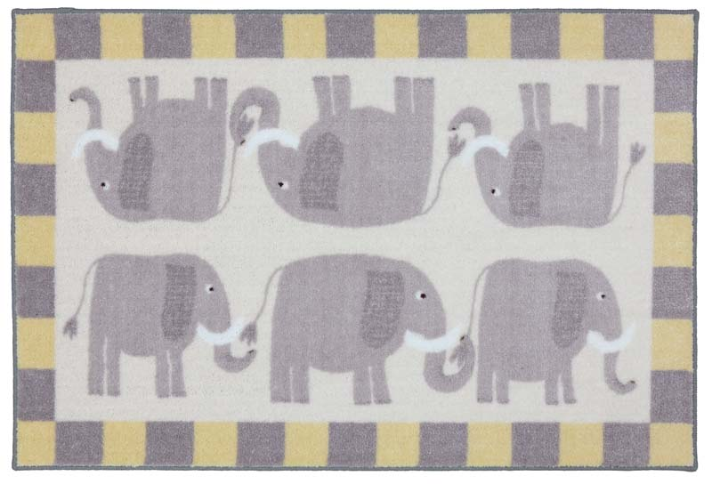 Sweet elephants parade in Elephants Grey, a fun nylon printed rug design from American Rug Craftsmen's Crib to College collection. mohawkhome.com
