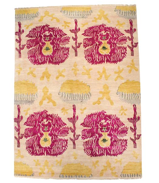 An ikat design from F.J. Kashanian's Sari Wool collection, in an ivory/fuchsia colorway. Made with 100 percent wool in Kashmir, India. Available in 6-by-9, 8-by-10, 9-by-12, 10-by-14 and 12-by-15.  fjkashanian.com