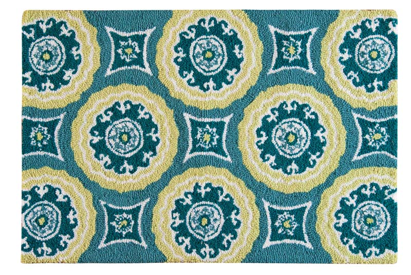 The new 2-by-3, washable Delilah Blue rug from C & F Enterprises includes sunlight yellow, blues and teals to form symmetrical medallions. cnfei.com