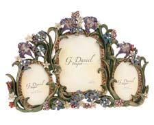 This handcrafted pewter frame from G. Daniel is embellished with delicate flowers and brightened with Swarovski elements. gdanielcollection.com