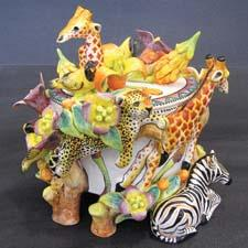 This handsculpted and handpainted one-of-a-kind ceramic trinket box is made in the Intu-Art pottery studio in Johannesburg, South Africa.  intu-art.com