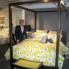 TV design personality Thom Filicia poses in the Welspun USA showroom with one of the bed ensembles in his new licensed collection with the company. Welspun launched the line during last month's New York Home Fashions Market.