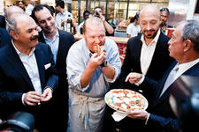 Chef Mario Batali, center, can't resist a bite of pizza at the opening of his latest project, Eataly, the new artisanal Italian food and wine marketplace in New York's Flatiron district. He's surrounded by, from left, Oscar Farinetti, the owner and founder of Eataly; Adam Saper, Eataly partner; Joe Bastianich, Batali-Bastianich (B&B) Hospitality Group; and New York's Mayor Mike Bloomberg.