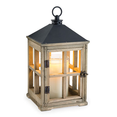 The stained wood framework, black metal top, and vintage-inspired metal door latch of the Wooden Candle Warmer Lantern combine to make a style statement. Place your favorite candle inside and enjoy the warm glow of a lit candle safely at home.