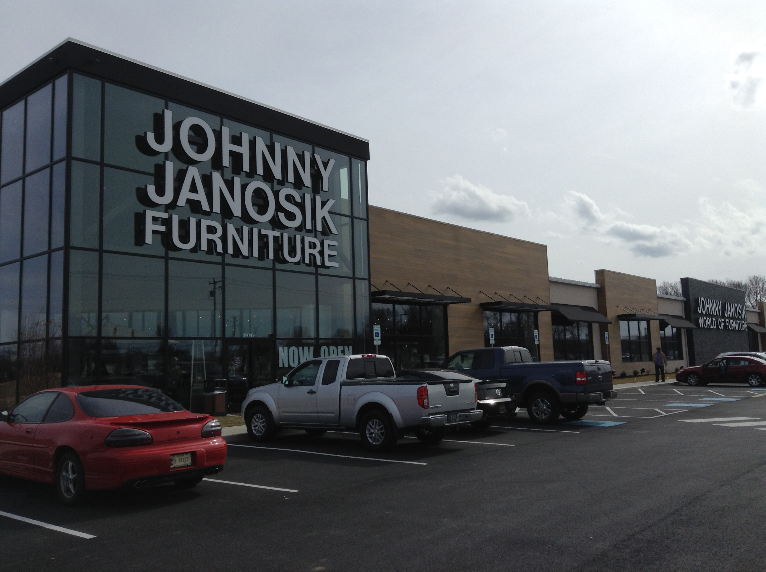 It's long on curb appeal. The retailer went for a modern and 400-foot long storefront for the wow factor when it decided to replace two dated former showrooms here.