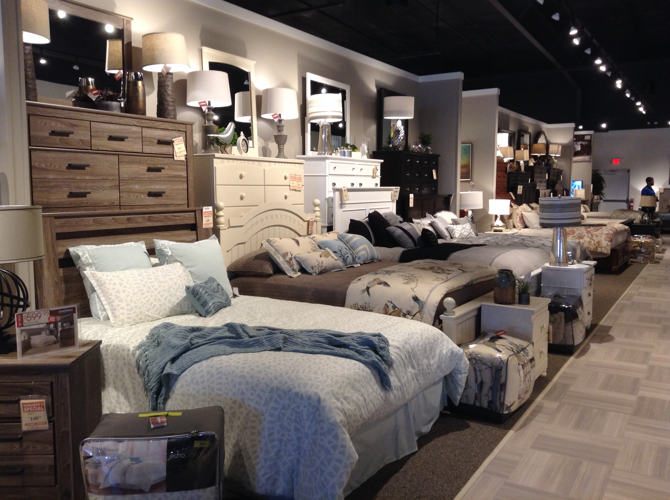 It employs vertical efficiency to display a lot of bedroom groups (ranging from about $999 to $2399) in a small space.