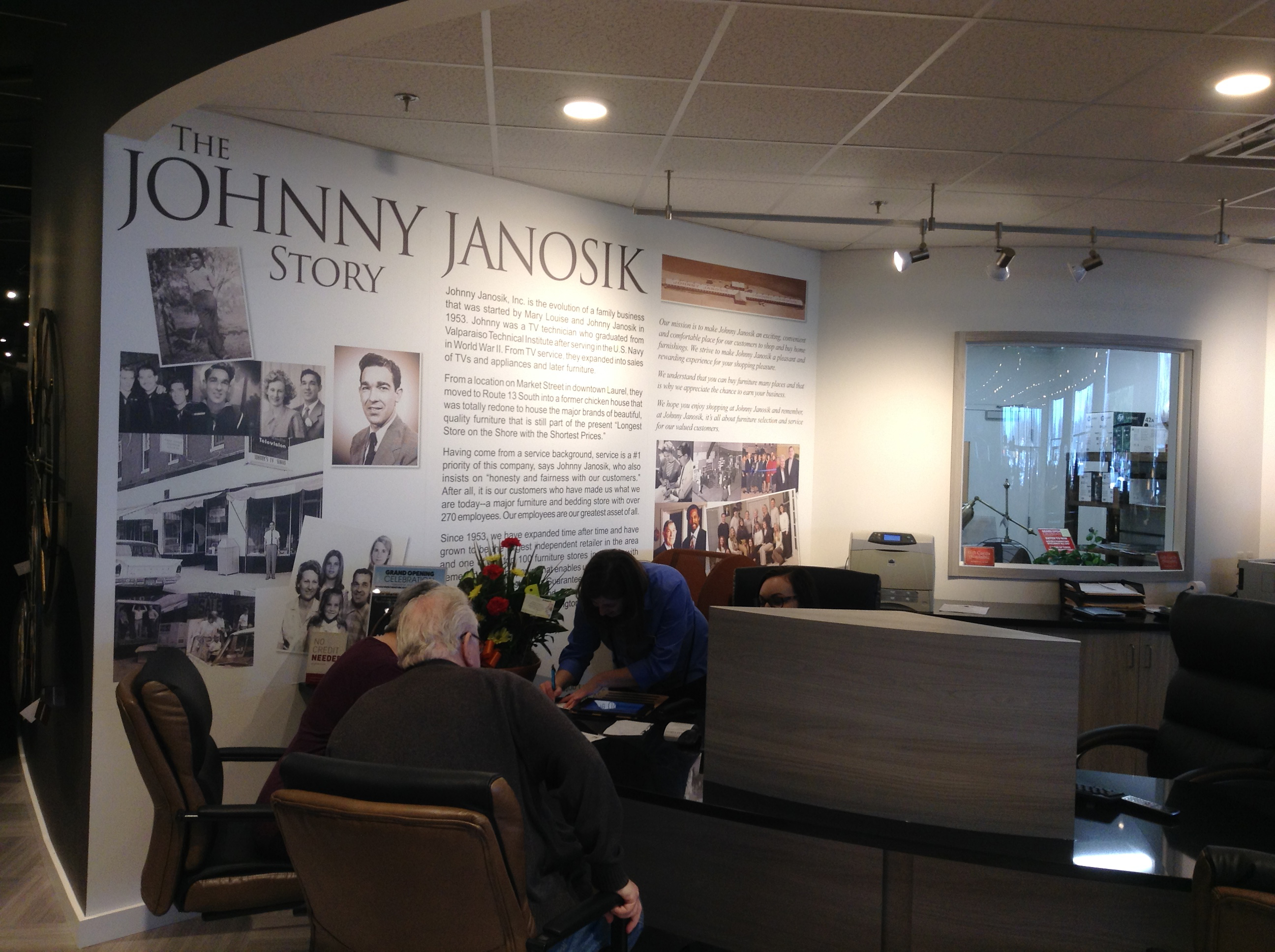 The retailer doesn't forget where it came from. A history wall in the customer service area tells the story of the business founded in 1953 by the late Johnny Janosik and the emphasis the retailer has always placed on service — to customers and the community.
