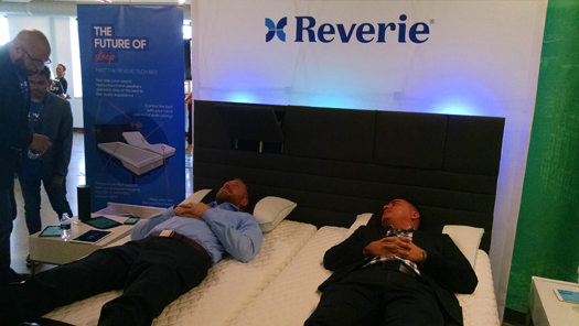 "Here, Thompson and Macias try out the ""Jedi"" bed from Reverie, an early stage concept bed that will use brainwave sensing technology to measure sleeps stages ""and react accordingly,"" for example, adjusting when it senses discomfort."