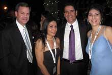 Bill Dominguez, Left, AICO; Xiomara Corves, El Dorado Furniture, Miami;