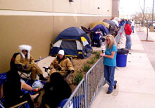 Some 300 people lined up for the opening of American Furniture Warehouse's store in Grand Junction, Colo., for special buys and the chance to walk away with free furniture and other gifts. Several braved freezing temperatures, camping in front of the store overnight.